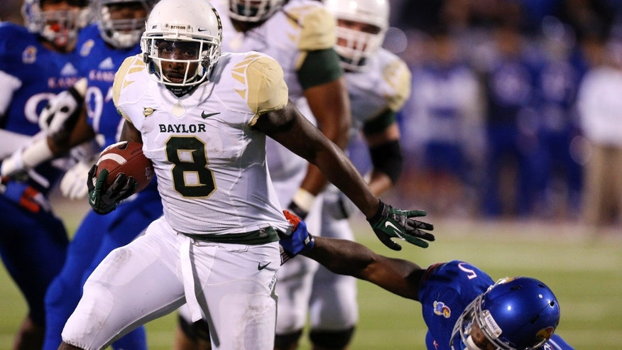 Baylor Bears running back Glasco Martin (8) runs past Kansas Jayhawks safety Isaiah Johnson (5) for a touchdown run in the first quarter of an NCAA college football game Saturday, Oct. 26, 2013, in Lawrence, Kan. (AP Photo/Ed Zurga)