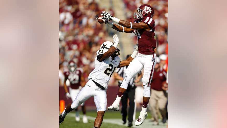 Texas A&M's Derel Walker, right, catches a pass over Vanderbilt's Paris Head (21) during the first half of an NCAA football game, Saturday, Oct. 26, 2013, in College Station, Texas. (AP Photo/Eric Christian Smith)