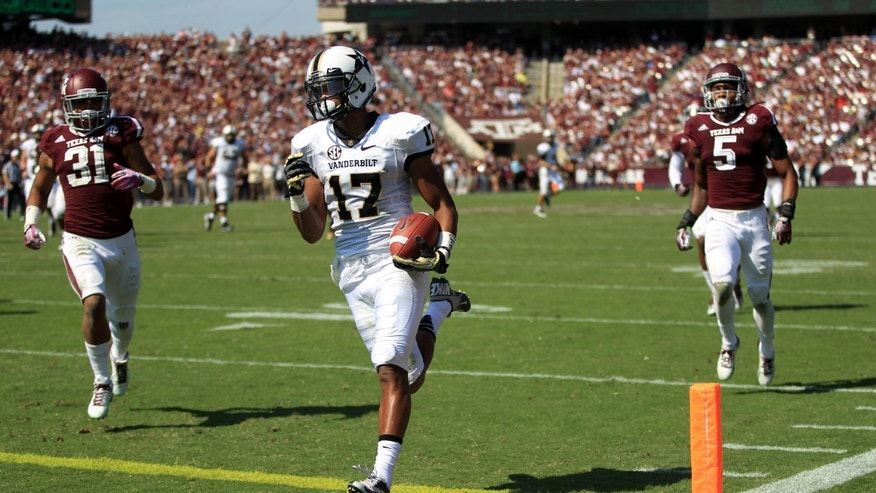 Vanderbilt's Jonathan Krause (17) scores a touchdown past Texas A&M's Howard Matthews (31) and Floyd Raven (5) during the first half of an NCAA football game, Saturday, Oct. 26, 2013, in College Station, Texas. (AP Photo/Eric Christian Smith)