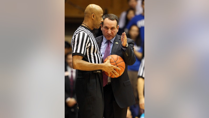 Duke coach Mike Krzyzweski speaks with an official during the first half of an exhibition NCAA college basketball game against the Bowie State in Durham, N.C., Saturday, Oct. 26, 2013. (AP Photo/Karl B. DeBlaker)