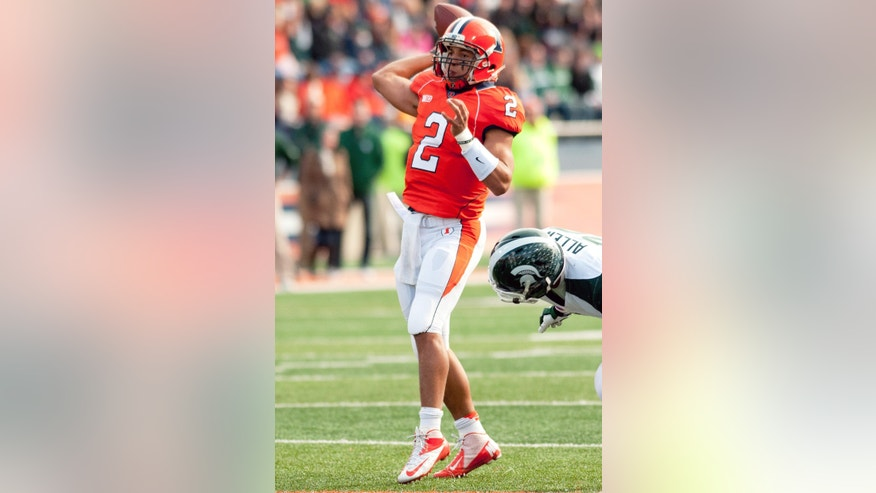 Illinois quarterback Nathan Scheelhaase (2) throws the ball against Michigan State during the first quarter of an NCAA college football game, Saturday, Oct. 26, 2013 at Memorial Stadium in Champaign, Ill. (AP Photo/Bradley Leeb)