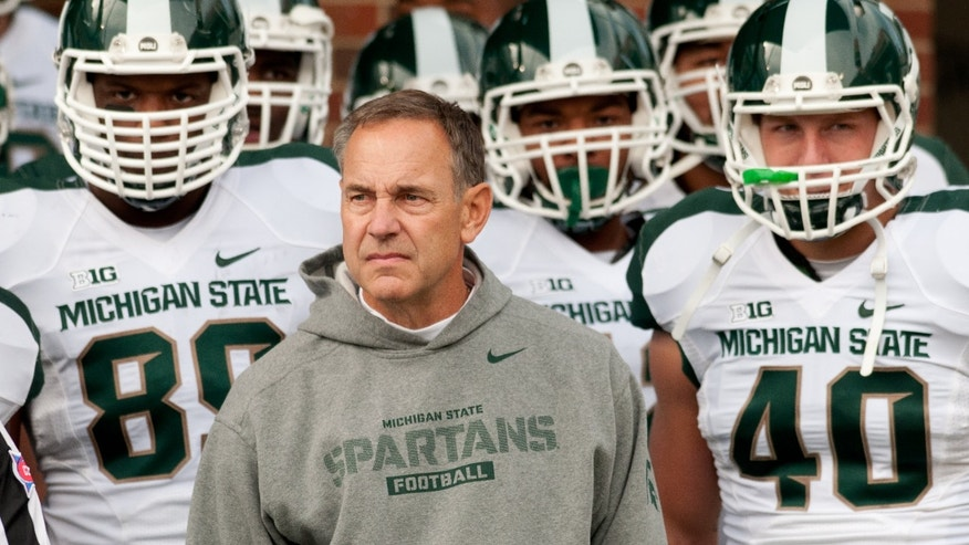 Michigan State head coach Mike Dantonio prepares to lead the team on the field before the game against Illinois at an NCAA college football game, Saturday, Oct. 26, 2013 at Memorial Stadium in Champaign, Ill. (AP Photo/Bradley Leeb)