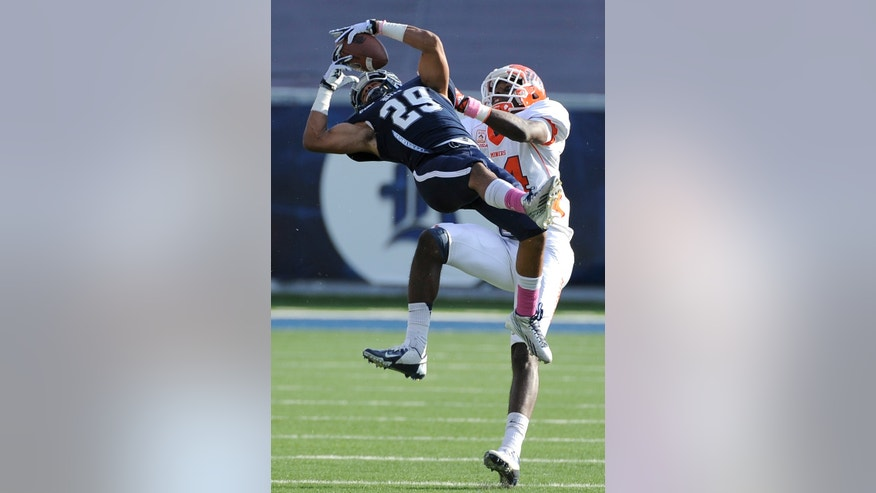 Rice's Bryce Callahan (29) intercepts a pass meant for UTEP 's Ian Hamilton (14) in the second half of an NCAA college football game Saturday, Oct. 26, 2013, in Houston. Rice won 45-7. (AP Photo/Pat Sullivan)