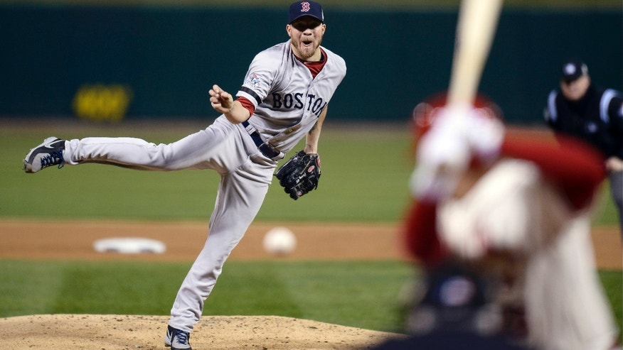 Boston Red Sox starting pitcher Jake Peavy throws during the first inning of Game 3 of Game 3 of baseball's World Series against the St. Louis Cardinals Saturday, Oct. 26, 2013, in St. Louis. (AP Photo/Tannen Maury, Pool)
