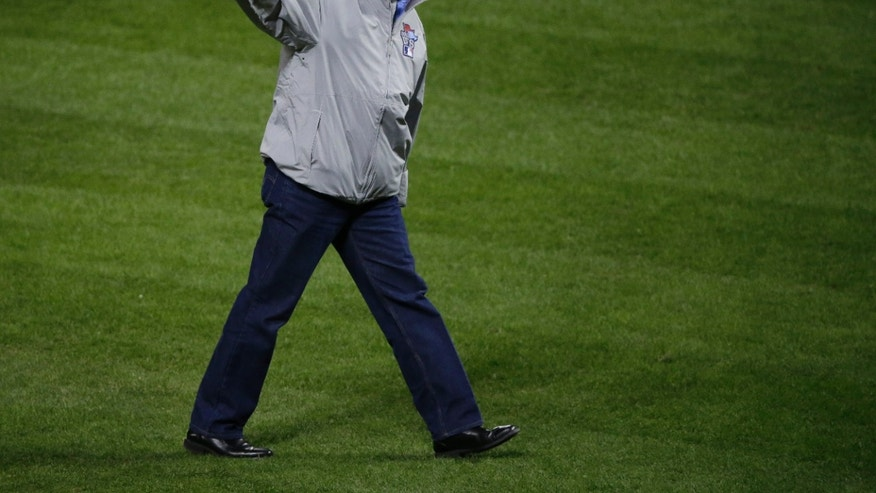 Former St. Louis Cardinals' Willie McGee wave to fans after throwing out the ceremonial first pitch before Game 3 of baseball's World Series between the Boston Red Sox and the St. Louis Cardinals Saturday, Oct. 26, 2013, in St. Louis. (AP Photo/Charlie Neibergall)