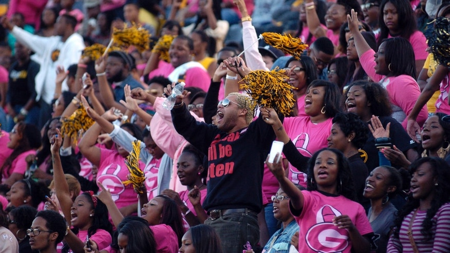 Grambling State University fans show their support for the school's football team in the second half of an NCAA College football game against Texas Southern, in Grambling, La., Saturday, Oct. 26, 2013. (AP Photo/Kita Wright)