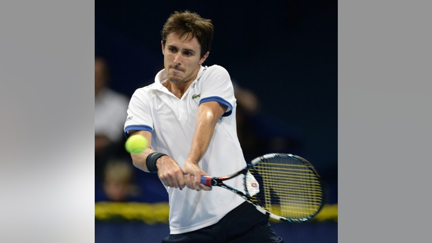 France's Edouard Roger-Vasselin returns a ball to Argentina's Juan Martin Del Potro during their semifinal match at the Swiss Indoors tennis tournament in Basel, Switzerland, on Saturday, Oct. 26, 2013.   (AP Photo/Keystone,Georgios Kefalas)