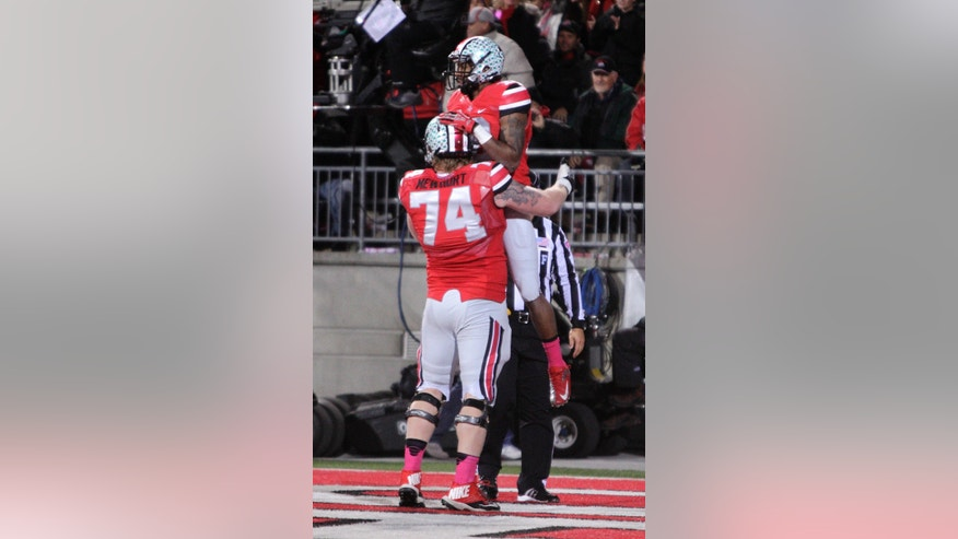 Ohio State offensive lineman Jack Mewhort, front, congratulates wide receiver Corey Brown on his touchdown against Penn State during the second quarter of an NCAA college football game Saturday, Oct. 26, 2013, in Columbus, Ohio. (AP Photo/Jay LaPrete)
