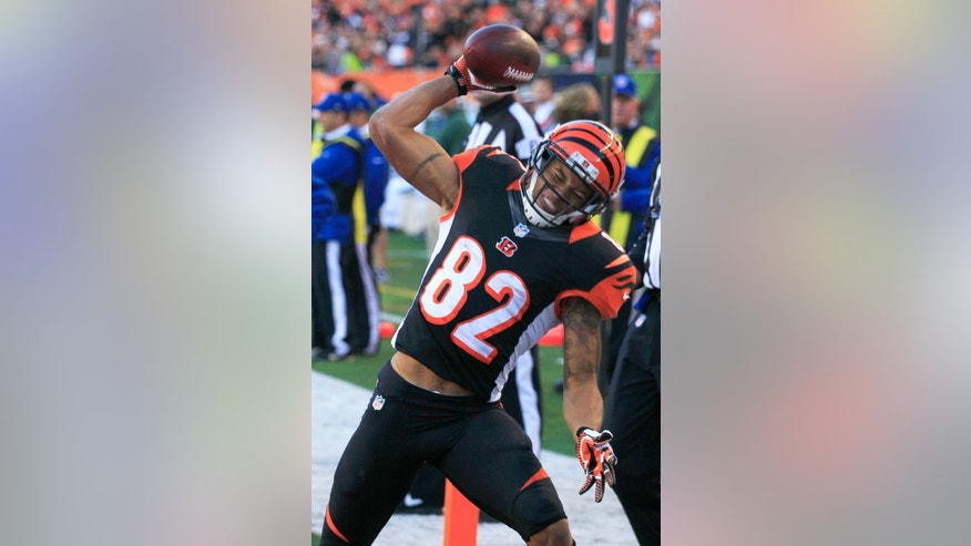 Cincinnati Bengals wide receiver Marvin Jones spikes the ball after catching an eight-yard touchdown pass against the New York Jets in the first half of an NFL football game, Sunday, Oct. 27, 2013, in Cincinnati. (AP Photo/Tom Uhlman)