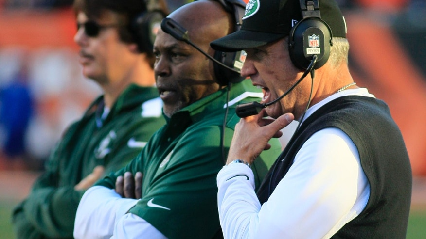 New York Jets head coach Rex Ryan, right, watches on the sidelines during the first half of an NFL football game against the Cincinnati Bengals, Sunday, Oct. 27, 2013, in Cincinnati. (AP Photo/Tom Uhlman)