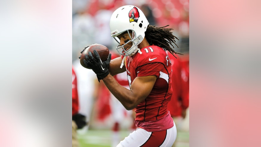 Arizona Cardinals wide receiver Larry Fitzgerald warms up prior to an NFL football game against the Atlanta Falcons, Sunday, Oct. 27, 2013, in Glendale, Ariz. (AP Photo/Rick Scuteri)