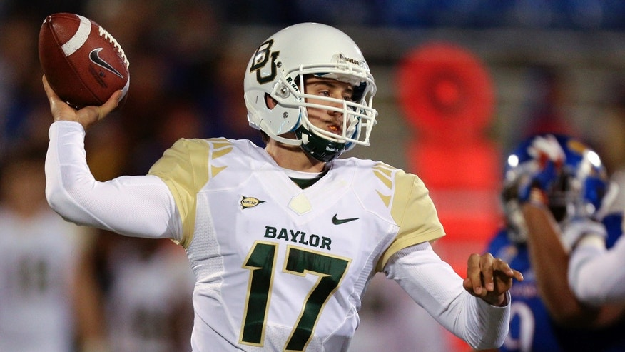 Baylor Bears quarterback Seth Russell throws in the third quarter of an NCAA college football game against the Kansas Jayhawks, Saturday, Oct. 26, 2013, in Lawrence, Kan. Baylor won 59-14. (AP Photo/Ed Zurga)