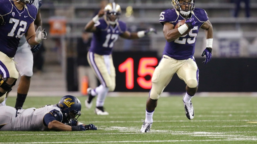 Washington's Bishop Sankey (25) takes off on a 59-yard touchdown run as quarterback Keith Price (17) cheers behind in the first half of an NCAA college football game against California Saturday, Oct. 26, 2013, in Seattle. (AP Photo/Elaine Thompson)