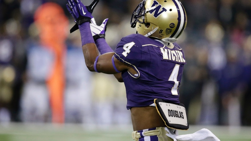 Washington's Jaydon Mickens catches the ball for a 68-yard touchdown reception against California in the first half of an NCAA college football game Saturday, Oct. 26, 2013, in Seattle. (AP Photo/Elaine Thompson)
