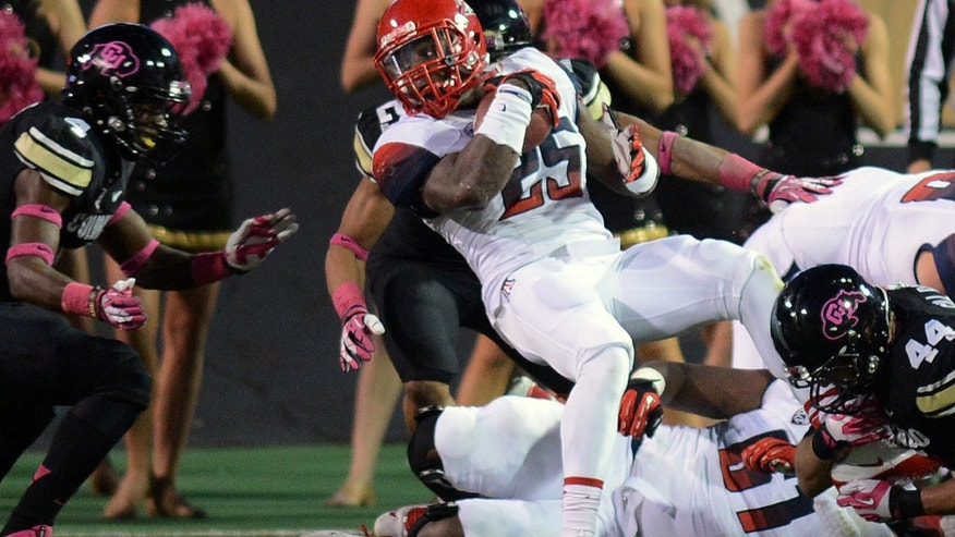Arizona's Ka'Deem Carey (25) tries to score against Colorado during an NCAA college football game on Saturday, Oct. 26, 2013, in Boulder, Colo. (AP Photo/The Daily Camera, Cliff Grassmick)