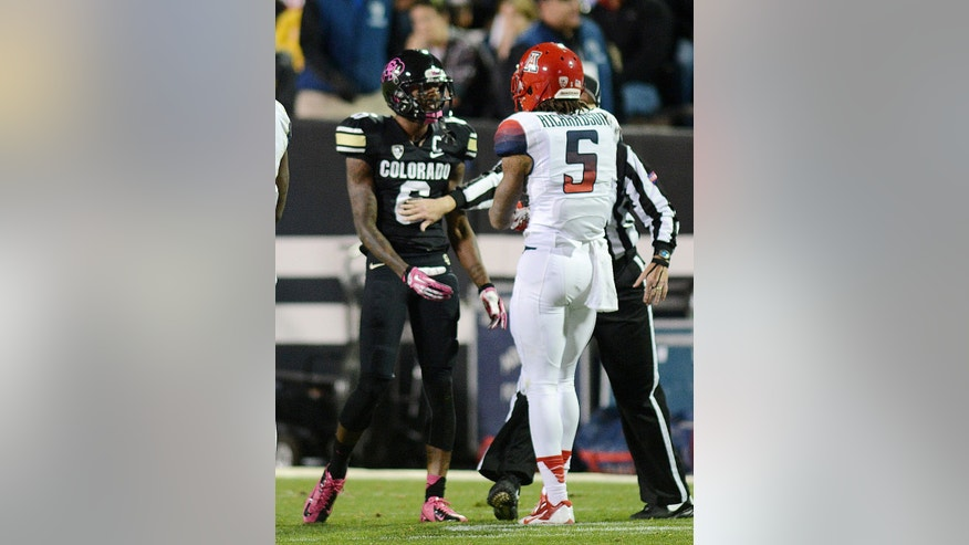 Paul Richadson, left, of Colorado talks with his cousin, Arizona's Shaq Richardson during an NCAA college football game on Saturday, Oct. 26, 2013, in Boulder, Colo. (AP Photo/The Daily Camera, Cliff Grassmick)