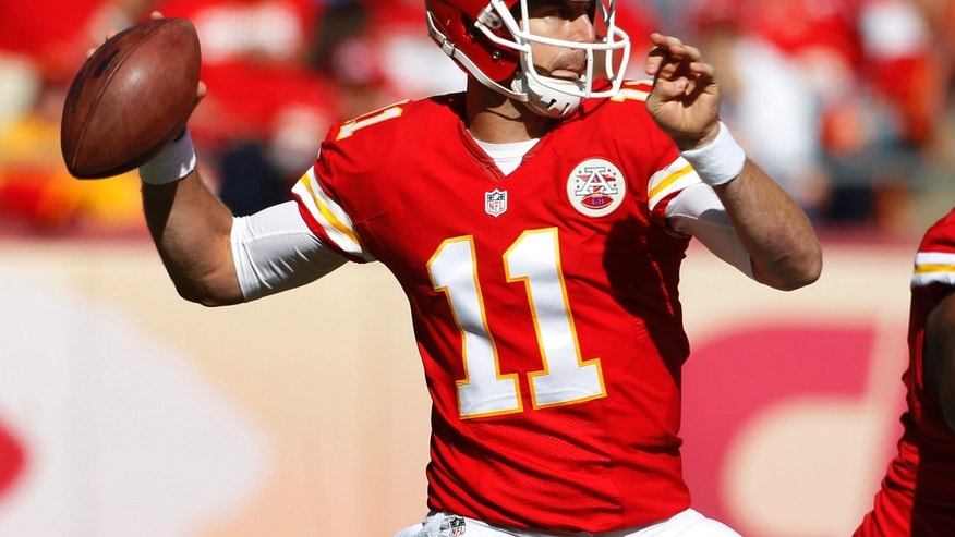 Kansas City Chiefs quarterback Alex Smith (11) throws a pass during the first half of an NFL football game against the Cleveland Browns in Kansas City, Mo., Sunday, Oct. 27, 2013. (AP Photo/Colin E. Braley)