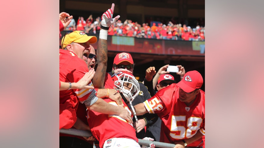 Kansas City Chiefs wide receiver Dexter McCluster (22) celebrates his touchdown with fans during the first half of an NFL football game against the Cleveland Browns in Kansas City, Mo., Sunday, Oct. 27, 2013. (AP Photo/Ed Zurga)