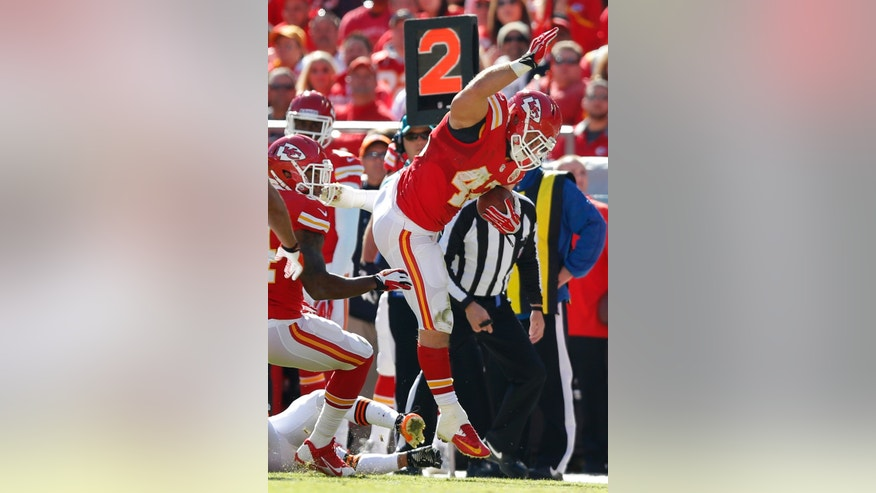 Kansas City Chiefs fullback Anthony Sherman (42) avoids a tackle on a touchdown run during the first half of an NFL football game against the Cleveland Browns in Kansas City, Mo., Sunday, Oct. 27, 2013. (AP Photo/Ed Zurga)