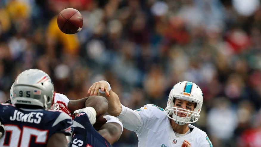 Miami Dolphins quarterback Ryan Tannehill (17) passes against the New England Patriots in the first quarter of an NFL football game on Sunday, Oct. 27, 2013, in Foxborough, Mass. (AP Photo/Michael Dwyer)