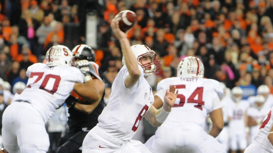 Stanford's Kevin Hogan throws against Oregon State during the first half of an NCAA college football game in Corvallis, Ore., Saturday Oct. 26, 2013. (AP Photo/Greg Wahl-Stephens)