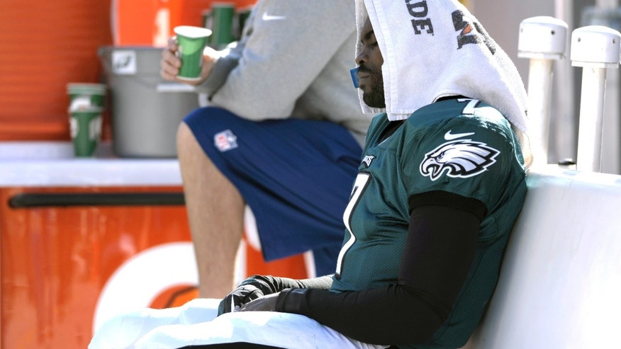 Philadelphia Eagles' Michael Vick (7) sits on the bench during the first half of an NFL football game against the New York Giants on Sunday, Oct. 27, 2013, in Philadelphia. (AP Photo/Michael Perez)