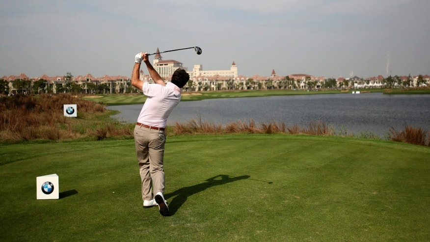 Spain's Gonzalo Fernandez-Castano tees off on the 9th hole during the final round of the BMW Masters golf tournament at the Lake Malaren Golf Club in Shanghai, China, Sunday, Oct. 27, 2013. (AP Photo/Eugene Hoshiko)