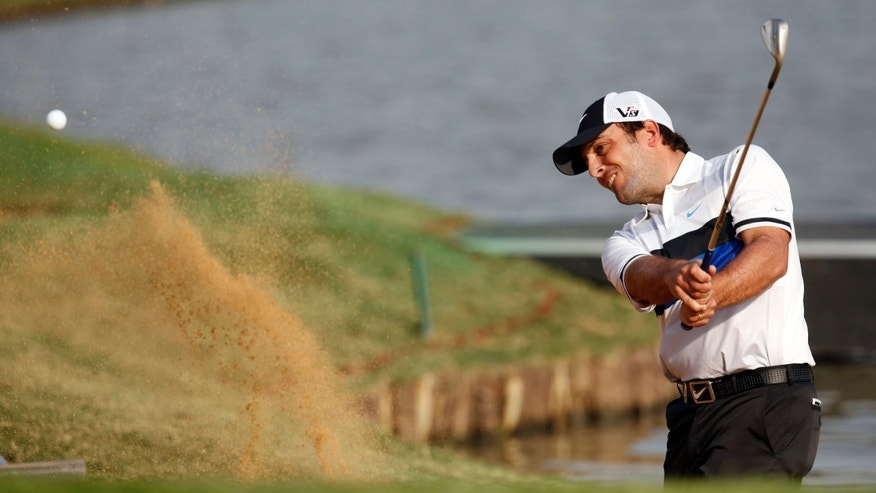 Francesco Molinari of Italy hits out of a bunker on the 18th green during the final round of the BMW Masters golf tournament at the Lake Malaren Golf Club in Shanghai, China, Sunday, Oct. 27, 2013. (AP Photo/Eugene Hoshiko)