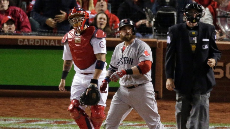 Boston Red Sox's Jonny Gomes watches his three-run home run during the sixth inning of Game 4 of baseball's World Series against the St. Louis Cardinals Sunday, Oct. 27, 2013, in St. Louis. (AP Photo/Charlie Riedel)