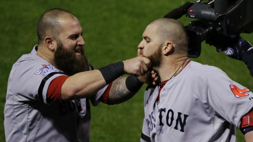 Boston Red Sox Mike Napoli, right, pulls Jonny Gomes' beard after Gomes hit a three run home run off of St. Louis Cardinals relief pitcher Seth Maness, left, during the sixth inning of Game 4 of baseball's World Series Sunday, Oct. 27, 2013, in St. Louis.(AP Photo/Charlie Neibergall)