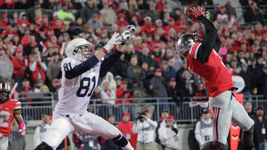 Ohio State defensive back Corey Brown, right, grabs an interception in the end zone in front of Penn State tight end Adam Breneman during the first quarter of an NCAA college football game Saturday, Oct. 26, 2013, in Columbus, Ohio. (AP Photo/Jay LaPrete)