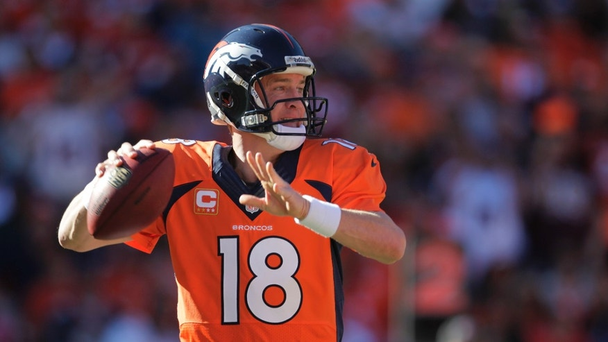 Denver Broncos quarterback Peyton Manning (18) throws against the Washington Redskins in the first quarter of an NFL football game, Sunday, Oct. 27, 2013, in Denver. (AP Photo/Joe Mahoney)