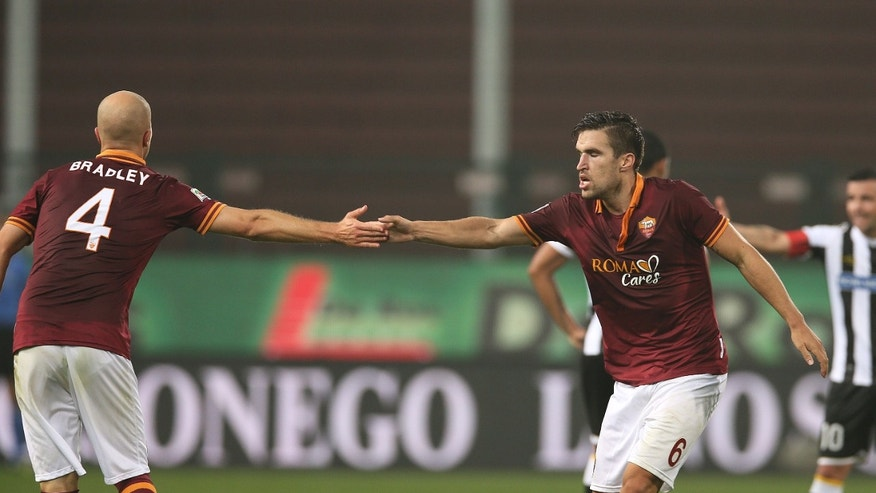 Roma's Michael Bradley, left, celebrates with teammates Kevin Strootman, after scoring during the Serie A soccer match between Udinese and Roma, at the Friuli Stadium in Udine, Italy, Sunday, Oct. 27, 2013. (AP Photo/Paolo Giovannini)