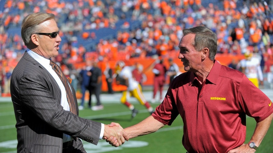 Washington Redskins Mike Shanahan, right, greets Denver Broncos executive vice president of football operations John Elway before an NFL football game, Sunday, Oct. 27, 2013, in Denver. (AP Photo/Jack Dempsey)