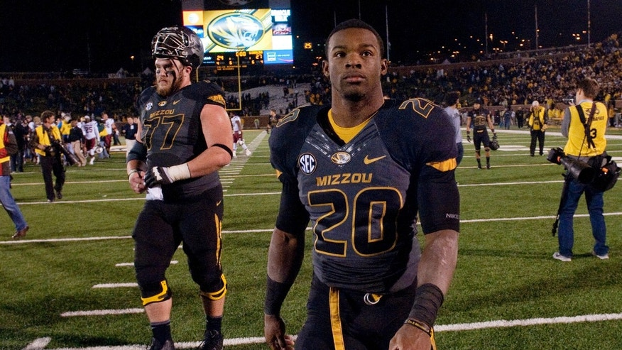 Missouri running back Henry Josey, right, walks off the field with teammate Evan Boehm, left, after the 27-24 loss to South Carolina in an NCAA college football game Saturday, Oct. 26, 2013, in Columbia, Mo. (AP Photo/L.G. Patterson)