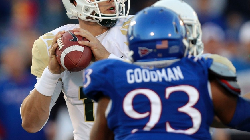Baylor Bears quarterback Bryce Petty, left, looks to pass in the first quarter of an NCAA college football game against the Kansas Jayhawks, Saturday, Oct. 26, 2013, in Lawrence, Kan. (AP Photo/Ed Zurga)