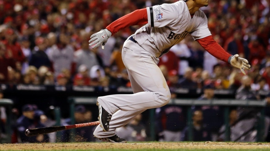 Boston Red Sox's Xander Bogaerts hits an RBI single during the eighth inning of Game 3 of baseball's World Series against the St. Louis Cardinals Saturday, Oct. 26, 2013, in St. Louis. (AP Photo/Jeff Roberson)