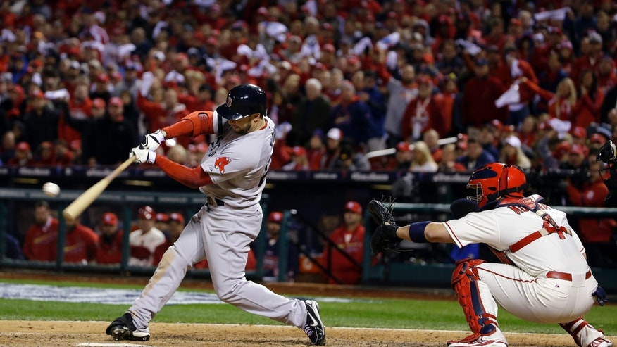 Boston Red Sox's Daniel Nava hits into a fielders choice during the eighth inning of Game 3 of baseball's World Series against the St. Louis Cardinals Saturday, Oct. 26, 2013, in St. Louis. Jacoby Ellsbury scored on the fields choice. (AP Photo/Matt Slocum)