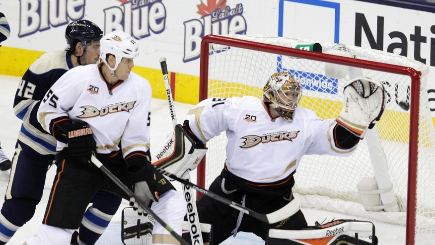 Anaheim Ducks' Frederick Andersen, right, of Denmark, makes a save as teammate Bryan Allen, center, and Columbus Blue Jackets' Artem Anisimov, of Russia, wait for the rebound during the third period of an NHL hockey game Sunday, Oct. 27, 2013, in Columbus, Ohio. The Ducks beat the Blue Jackets 4-3. (AP Photo/Jay LaPrete)