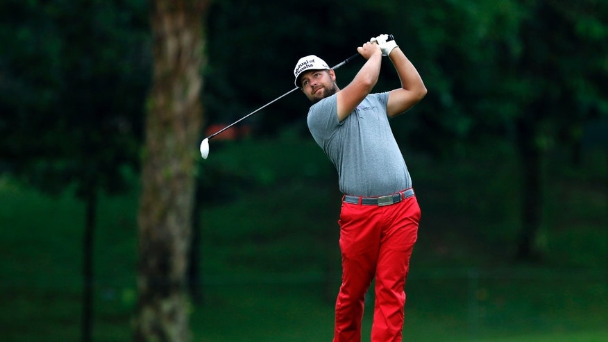 Ryan Moore of the U.S. watches his shot in a playoff of the CIMB Classic golf tournament at the Kuala Lumpur Golf and Country Club in Kuala Lumpur, Malaysia, Monday, Oct. 28, 2013. (AP Photo/Lai Seng Sin)