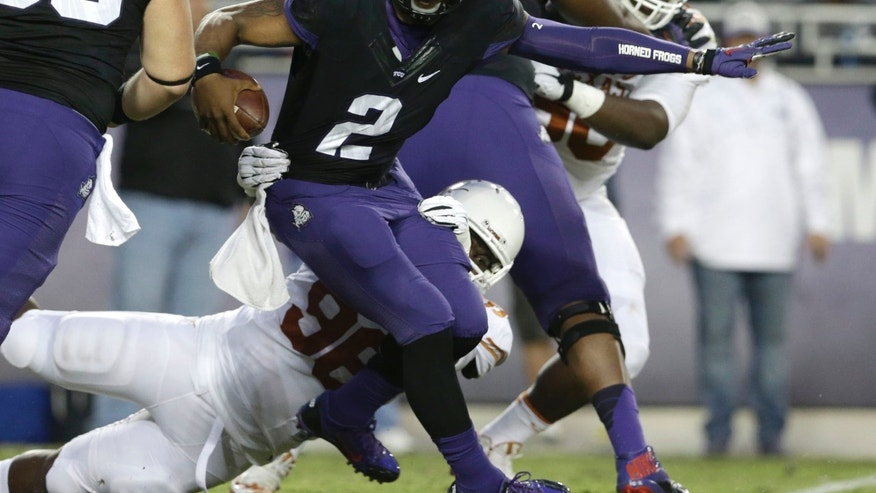 TCU quarterback Trevone Boykin (2) is sacked by TCU defensive tackle Jon Lewis (98) during the first half of an NCAA college football game on Saturday, Oct. 26, 2013, in Fort Worth, Texas. (AP Photo/LM Otero)