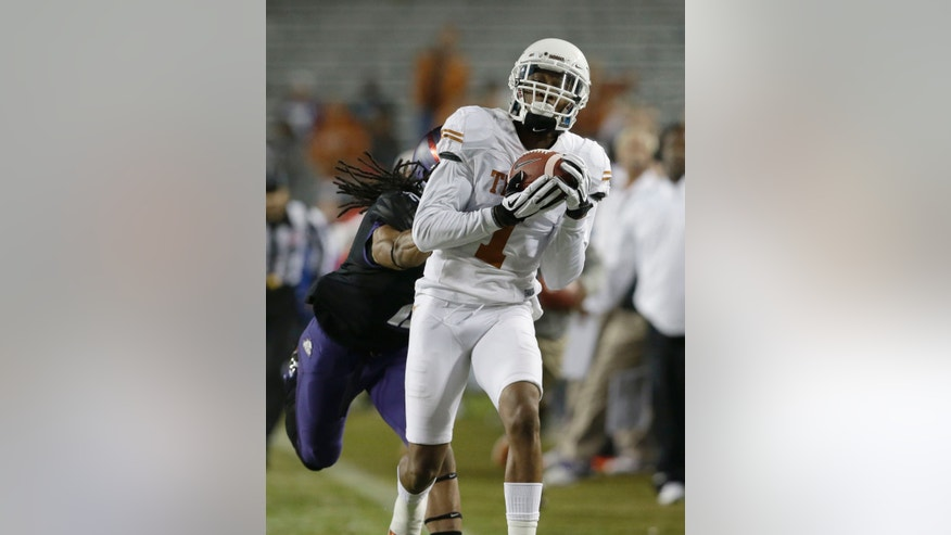 Texas wide receiver Mike Davis (1) catches a pass against TCU cornerback Jason Verrett (2) during the second half on an NCAA college football game Saturday, Oct. 26, 2013, in Fort Worth, Texas. (AP Photo/LM Otero)