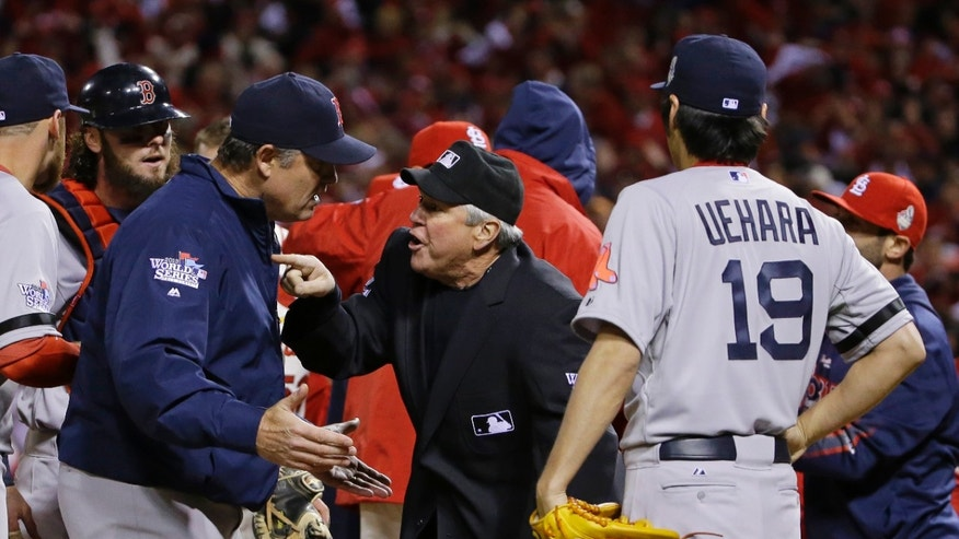 Boston Red Sox manager John Farrell argues with home plate umpire Dana DeMuth after St. Louis Cardinals scored the winning run on an obstruction play during the ninth inning of Game 3 of baseball's World Series Saturday, Oct. 26, 2013, in St. Louis. The Cardinals won 5-4 to take a 2-1 lead in the series. (AP Photo/Matt Slocum)