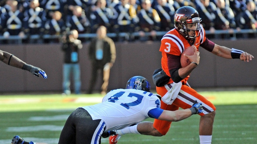Virginia Tech's Logan Thomas (3) gains yardage against Duke's David Helton (47) during the first half of an NCAA college football game in Blacksburg, Va., Saturday, Oct. 26, 2013. (AP Photo/Don Petersen)