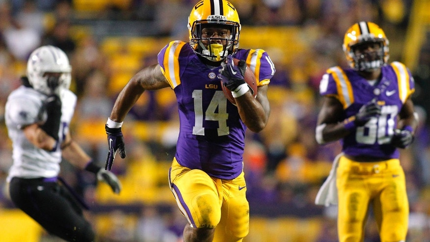 LSU running back Terrence Magee (14) runs for a 39-yard touchdown against Furman during the fourth quarter of an NCAA college football game in Baton Rouge, La., Saturday, Oct, 26, 2013. LSU won 48-16. (AP Photo/Jonathan Bachman)