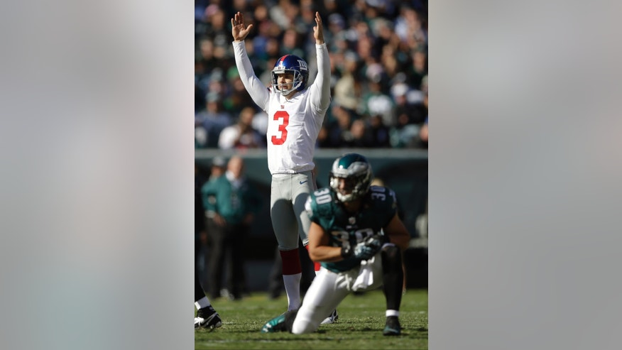 New York Giants kicker Josh Brown (3) celebrates as Philadelphia Eagles' Colt Anderson (30) reacts after Brown kicked a field goal during the first half of an NFL football game Sunday, Oct. 27, 2013 in Philadelphia. (AP Photo/Matt Rourke)