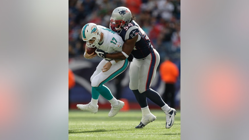 New England Patriots outside linebacker Dont'a Hightower (54) sacks Miami Dolphins quarterback Ryan Tannehill (17) in the third quarter of an NFL football game Sunday, Oct. 27, 2013, in Foxborough, Mass. (AP Photo/Steven Senne)