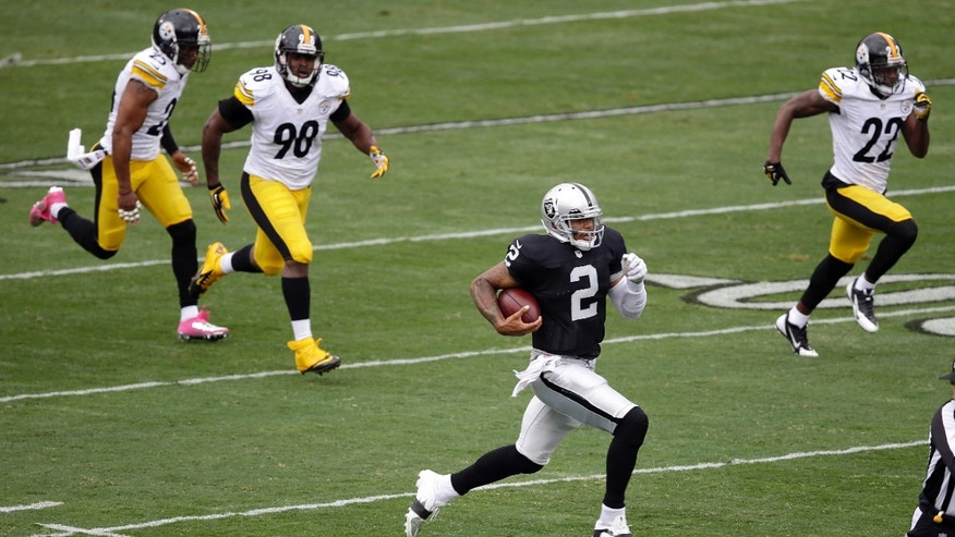 Oakland Raiders quarterback Terrelle Pryor (2) runs for a 93-yard touchdown past Pittsburgh Steelers free safety Ryan Clark, left, inside linebacker Vince Williams (98) and cornerback William Gay (22) during the first quarter of an NFL football game in Oakland, Calif., Sunday, Oct. 27, 2013. (AP Photo/Marcio Jose Sanchez)