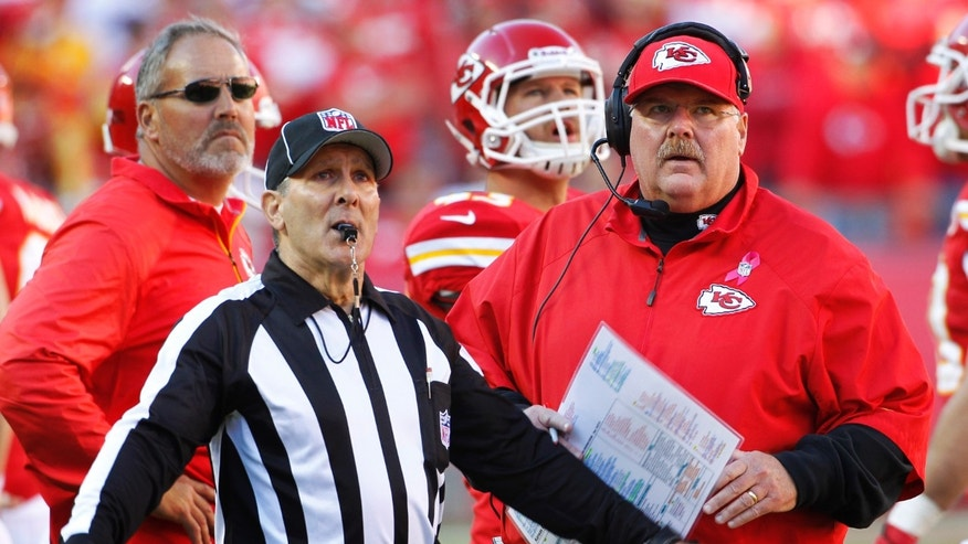 Kansas City Chiefs head coach Andy Reid, right, watches the clock with head linesman Tony Veteri, left, during the second half of an NFL football game against the Cleveland Browns in Kansas City, Mo., Sunday, Oct. 27, 2013. The Chiefs defeated the Browns 23-17. (AP Photo/Colin E. Braley)