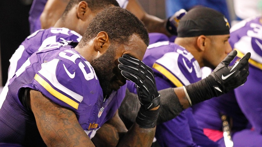 Minnesota Vikings outside linebacker Marvin Mitchell (55) hold his head near the end of an NFL football game against the Green Bay Packers, Sunday, Oct. 27, 2013, in Minneapolis. The Packers won 44-31. (AP Photo/Ann Heisenfelt)